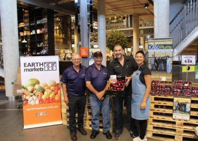 Earth-Markets-with-Kaso-Plums-growers-in-store-promotion