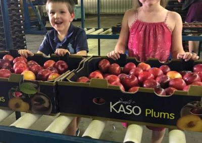 Kaden-and-Maya-with-Bette-Anne-plums
