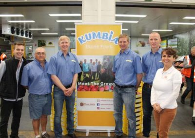 Montagues team member Elliott with growers at Kumbia product launch